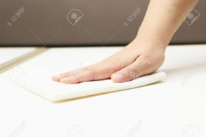 6803849-Hand-of-the-person-who-wipes-the-table--Stock-Photo
